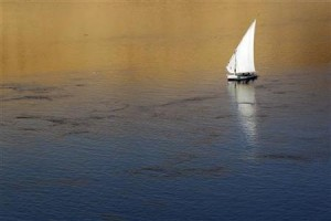 "Traditional Egyptian ""Felucca"" boat sails on the Nile river in the southern Egyptian city of Aswan"